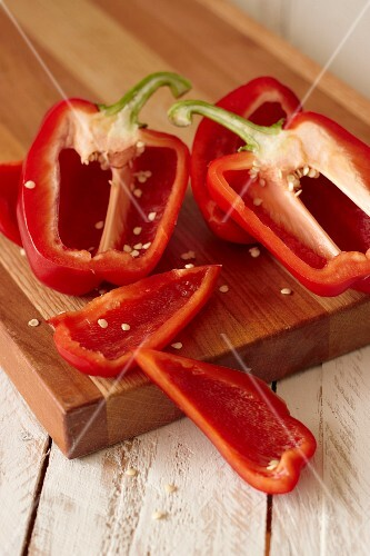 Halved and sliced red peppers
