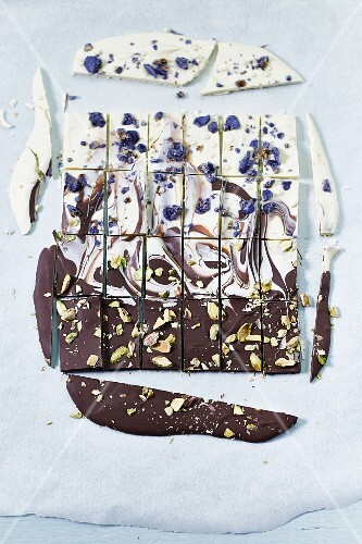 Chocolate with violets and pistachio nuts