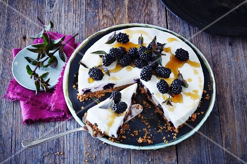 Cheesecake with blackberries, sliced