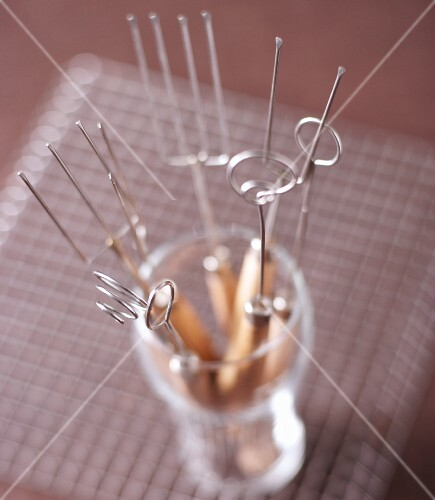 Various praline forks in a glass