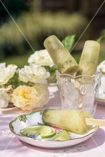 Lime ice lollies on a garden table