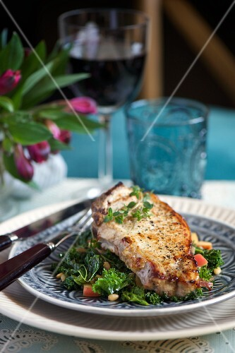 A pork chop with kale
