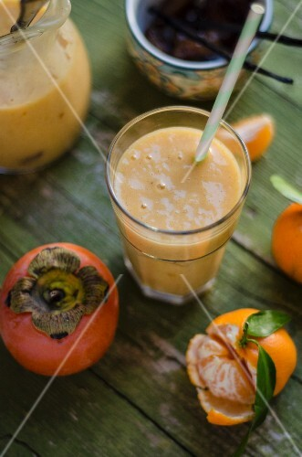 A persimmon and mandarin smoothie