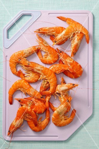 Cooked prawns on a chopping board