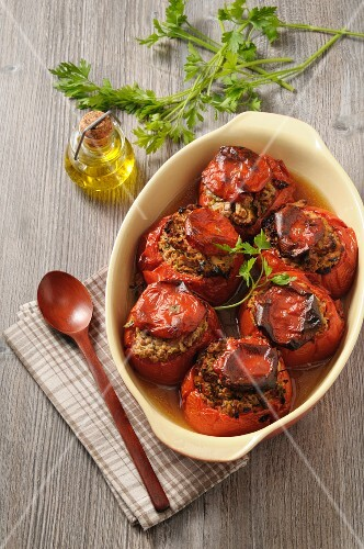 Stuffed tomatoes in a baking tin