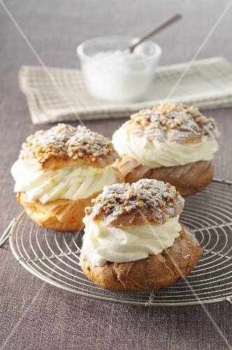 Profiteroles with cream, nuts and icing sugar