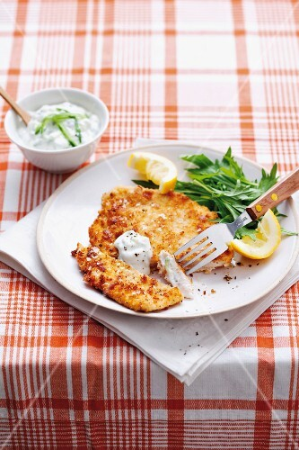 Chicken escalope with a fatty cheese crust and tzatziki