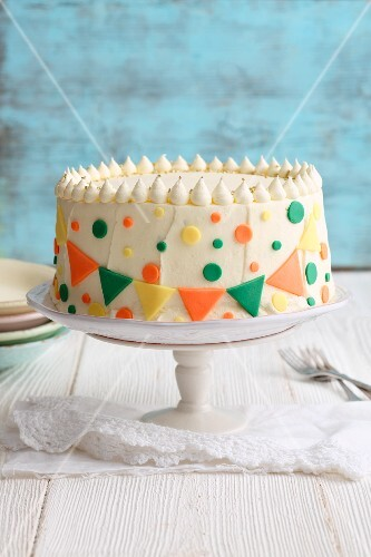 Berry mousse cake decorated with colourful confetti decorations
