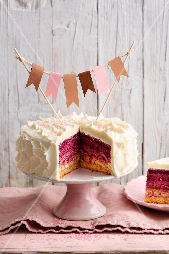 Raspberry and buttercream 'Surprice' cake