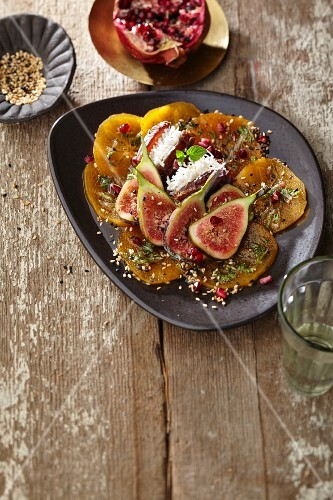 Marinated persimmons with dried dates, figs, fresh mint and roasted sesame seeds