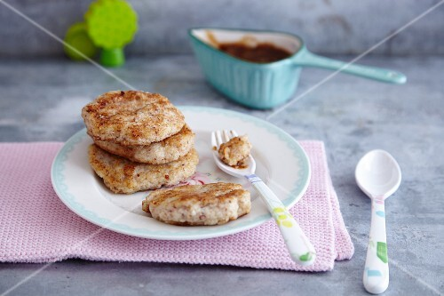 Semolina and almond fritters with dried plums