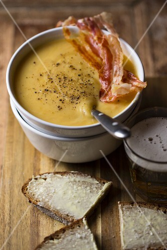 Potato soup with beef sausage and buttered bread