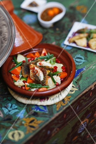 Fish tagine with vegetables and pomegranate seeds, Marrakesh, Morocco