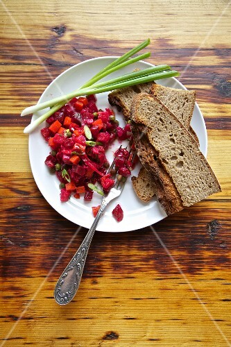 Russian beetroot salad with country bread and spring onions