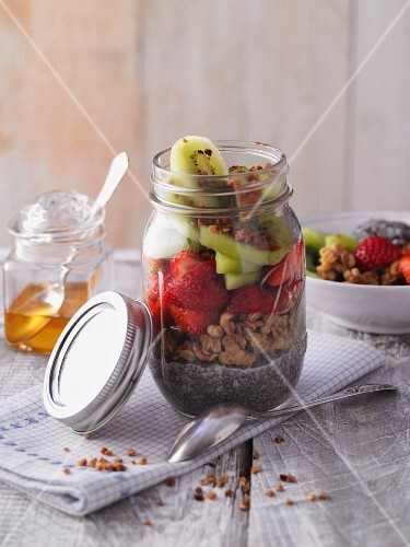 Crispy chia pudding with fruits in a jar