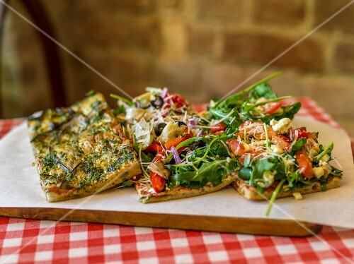 Focaccia with herbs, vegetables and rocket