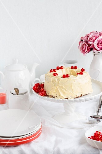 Chocolate cake with buttercream and redcurrants