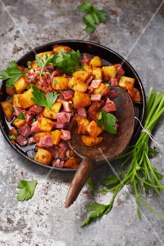 Fried potato salad with ham and a tomato dressing
