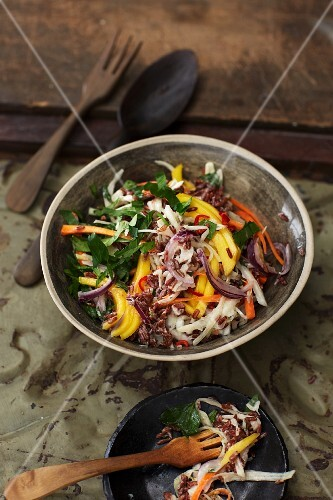 Red rice salad with mango and cream cheese dressing