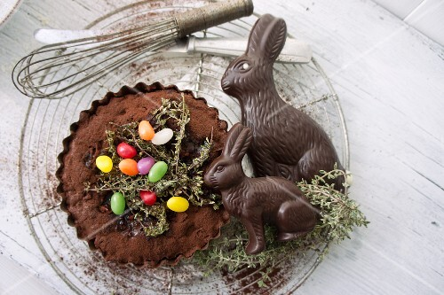 Chocolate tart with caramelised thyme, sugar eggs and chocolate Easter bunnies