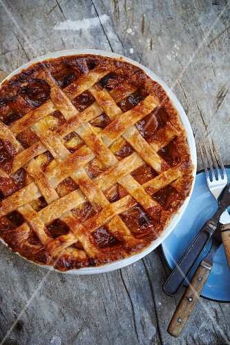 A peach pie with a lattice topping (seen from above)