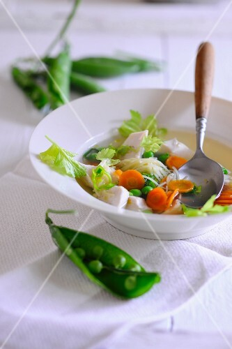 Chicken soup with peas and carrots
