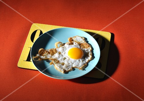 A fried duck egg on a plate