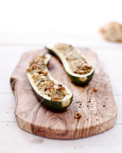 Stuffed grilled zucchini halves with sheep's cheese