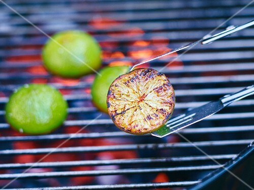 Lime halves being grilled on a barbecue