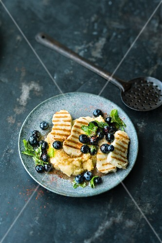 Grilled Halloumi with blueberries and mint on polenta
