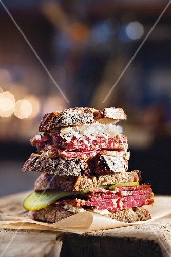 Two pastrami sandwiches stacked one on top of the other