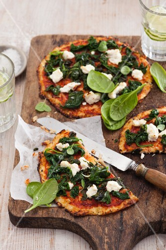 Vegetarian cauliflower pizza with spinach and ricotta