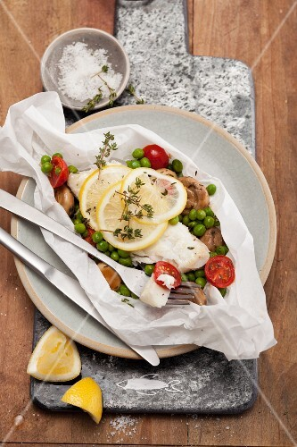 Cod fillet with vegetables in parchment paper