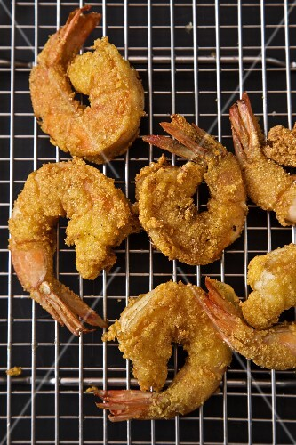 Fried prawns on a wire rack