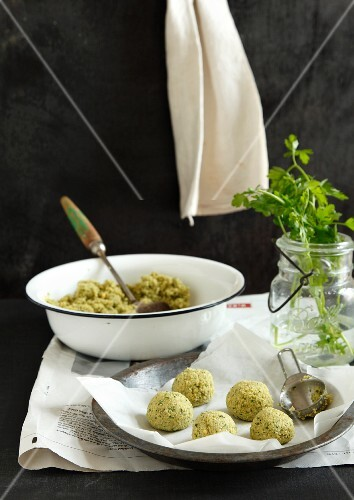 Raw falafel balls on a piece of parchment paper