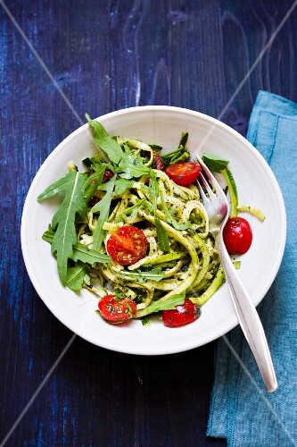 Courgette spaghetti with rocket pesto and cherry tomatoes