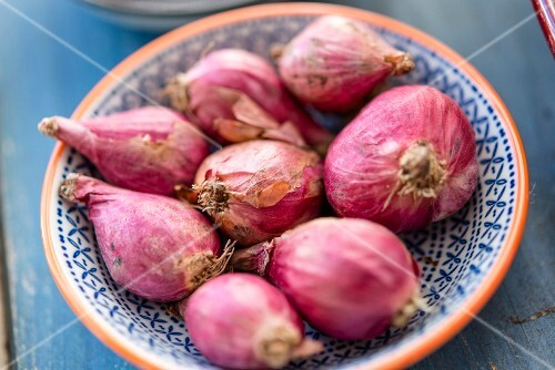 Red onions in a small porcelain bowl