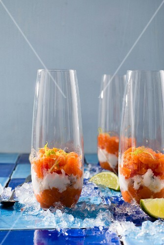 Layered desserts with papaya, coconut and lime