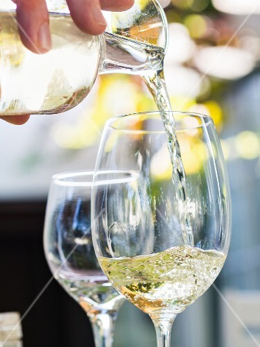 White South African wine being poured into a glass