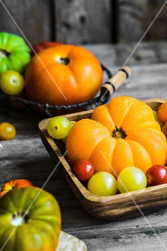 Colourful heirloom tomatoes on rustic wooden surface