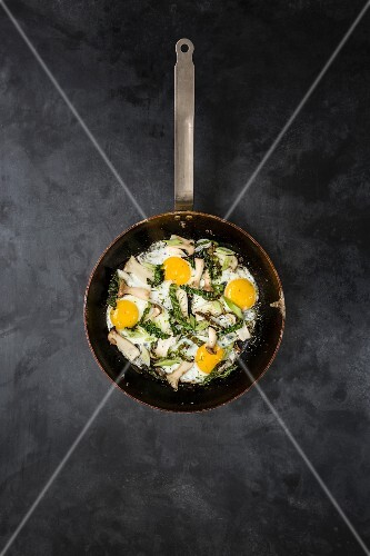 Fried mushrooms with fried eggs and strips of Savoy cabbage