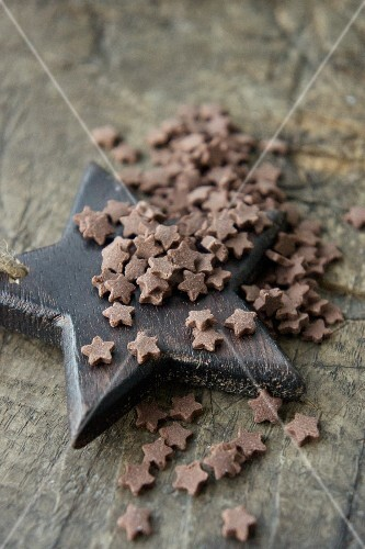 Chocolate stars on wooden surface