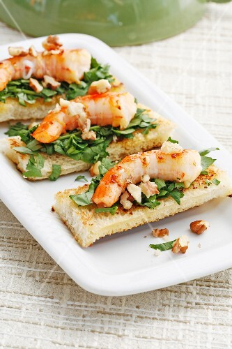 Baked king prawns with parsley salad on toast