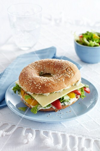Bagel filled with Gouda, grilled peppers and cream cheese