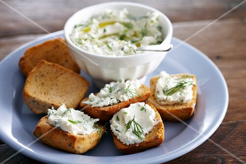Grilled bread with a herb and cream cheese spread