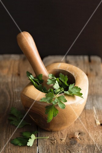 Fresh parsley in a wooden mortar