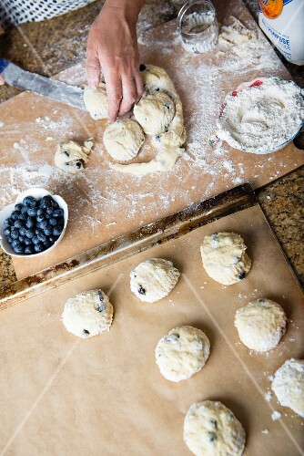 Blueberry scones being made: balls of dough being placed on a baking tray