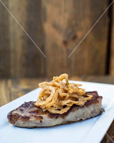 Grilled steak with roasted onion rings