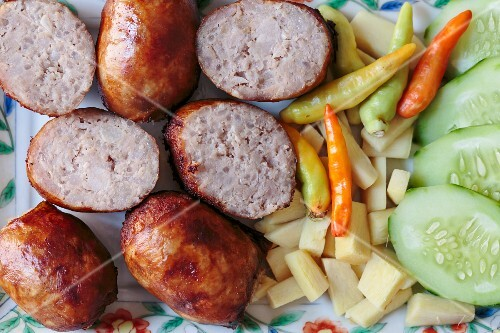 Fried pickled sausages with sides