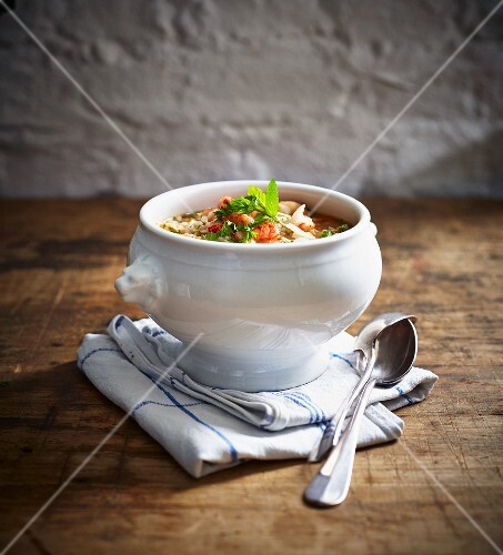Barley soup with crayfish in a soup bowl